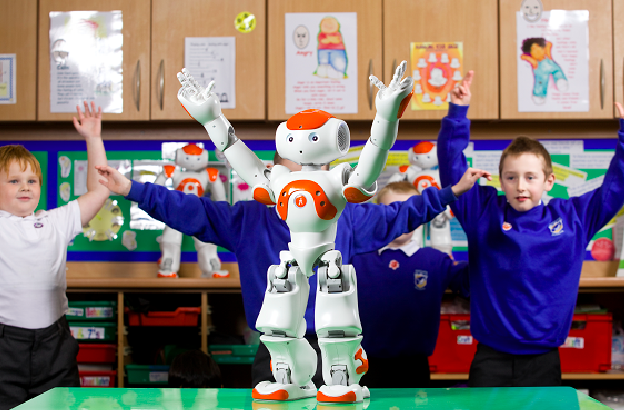The robot NAO, working with autistic children at Topcliffe primary school, in Birmingham (UK). The robot is produced by French technology company, Aldebaran Robotics.
